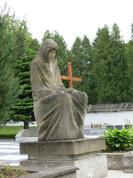 Statue next to gothic wooden church at Tvrdosin