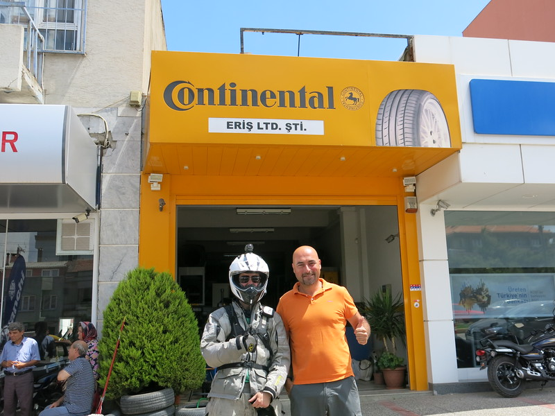 With Bora Eris at his tyre shop