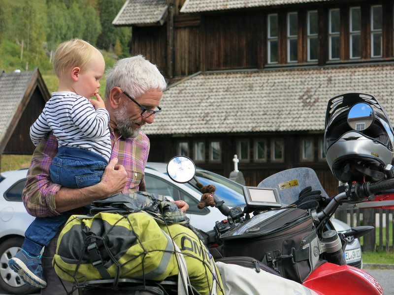 Checking out the bikes with his grandson
